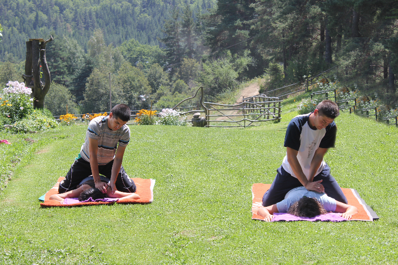 Holistic retreats - massage outdoors